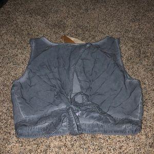 Cropped Tank tip ties and has a cutout in the back